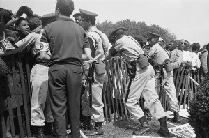 African American protestors behind a fence, August 28, 1963
