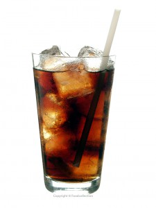 Cola with ice cubes and straw in a glass against a white background. Copyright © Foodcollection. MHE World.