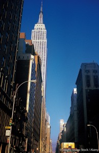 Street-level image of the Empire State Building as seen looking West from Park Avenue (probably on 35th Street). ©TongRo Image Stock / Alamy. MHE World.
