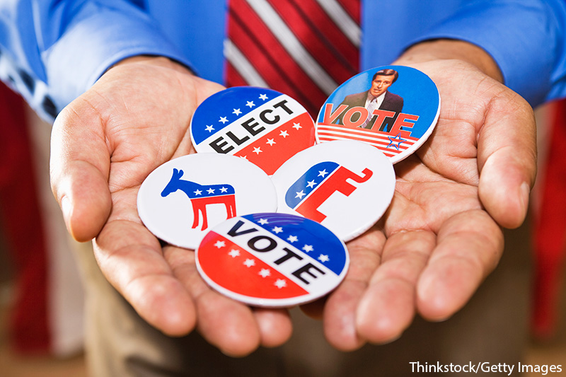 Close-up of hands holding five political election buttons or badges. Thinkstock/Getty Images. MHE Canada;MHE USA