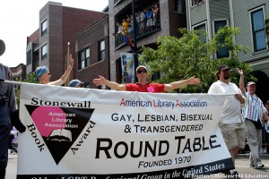 American Library Association Gay, Lesbian, Bisexual & Transgendered Round Table parade banner being carried by members in the Chicago gay pride parade. Jill Braaten/©McGraw-Hill Education. MHE World.