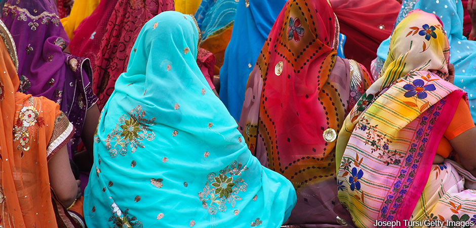 Back view of seated women wearing their finest and most colorful saris in wedding ceremony, Pushkar, India. Joseph Tursi/Getty Images. MHE Canada;MHE USA.
