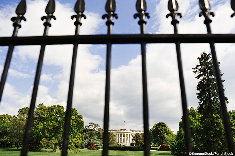 The White House in Washington, D.C. behind a iron fence.