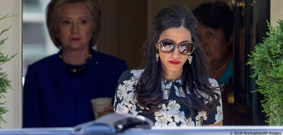 Top Clinton aide Huma Abedin walks ahead of Democratic presidential candidate Hillary Clinton following a private meeting with Sen. Elizabeth Warren, D-Mass., Friday, June 10, 2016, at Clinton's home in Washington.