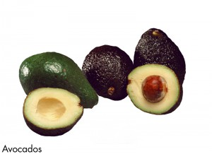 sliced avocadoes on white background