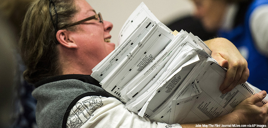 Election workers recount votes on Flint ballots, as they begin the process of a statewide recount on Wednesday, Dec. 7, 2016 at Genesee County Administration Building in Flint, Michigan