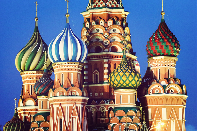 Detail view of some of the domes of the Cathedral of Vasily the Blessed (St. Basil's Cathedral) in Moscow's Red Square, Russia, illuminated against an evening sky. Credit: Philippe Jacquemart /EyeEm/Getty Images