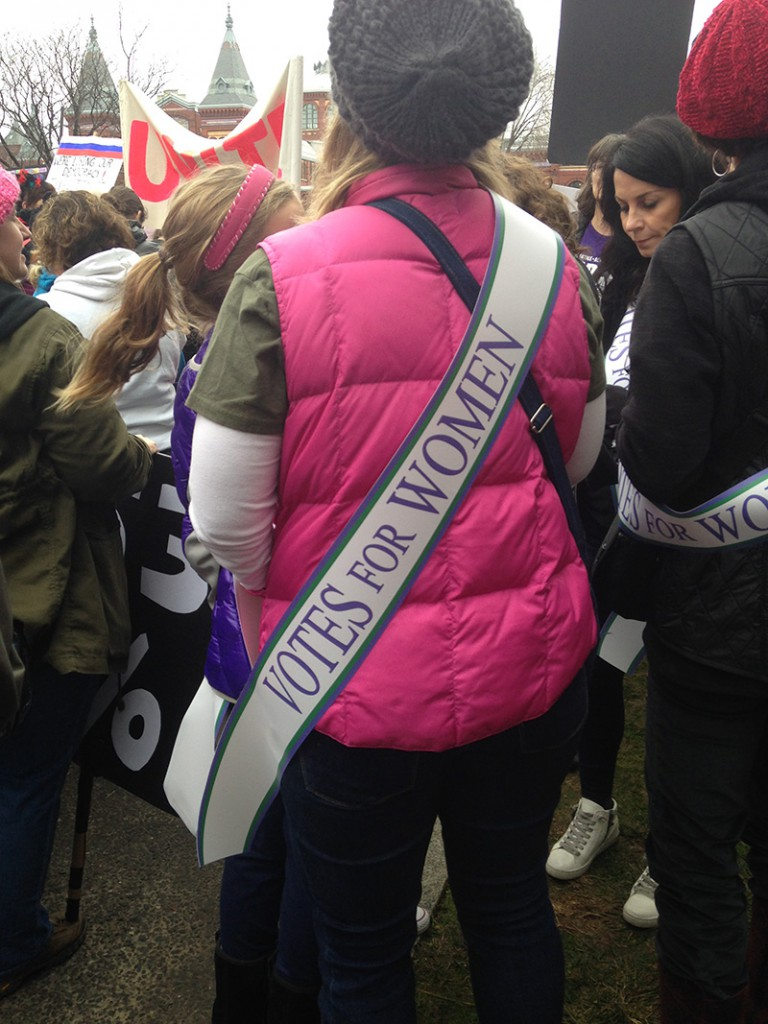 protester wearing sash
