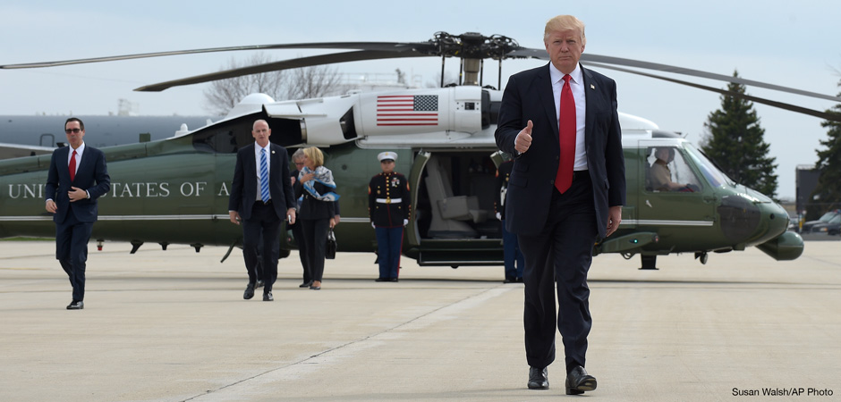 President Donald Trump gives a thumb-up as he walks from Marine to Air Force One at General Mitchell International Airport in Milwaukee