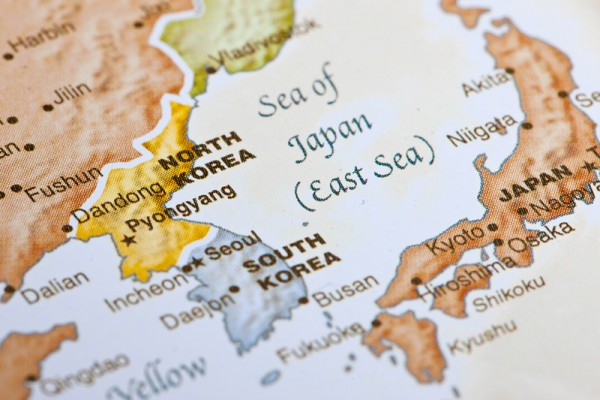 Detailed close-up view of a world map showing North Korea, South Korea, and Japan.